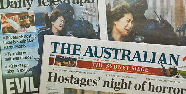Newspapers reporting on Lindt Cafe siege in Sydney in Dec 2014.
