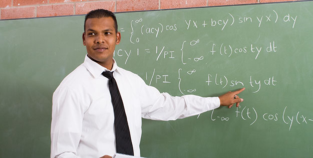 Young man teaching maths