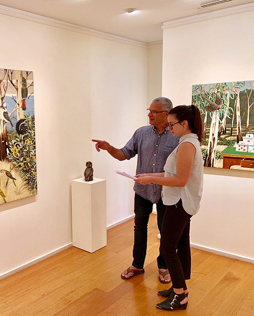 Jessica standing with artist Philip Davey in front of his exhibition.