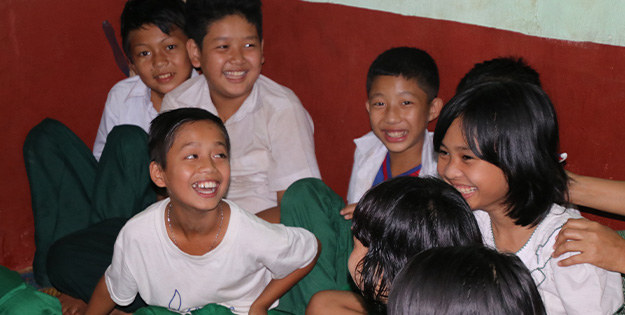Children enjoying a child club meeting, Myanmar.