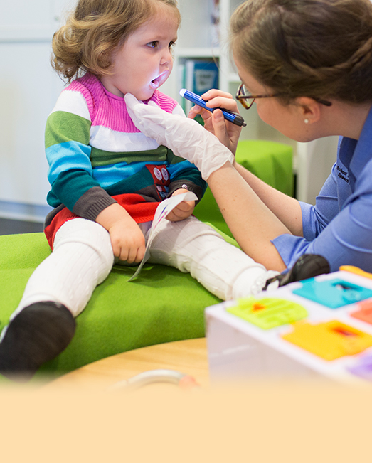 Speech pathologist working with a child